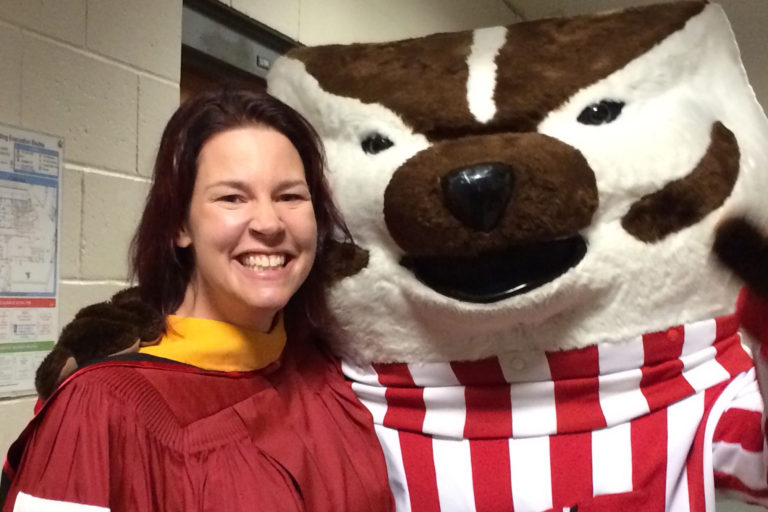 Karen Thompson, our Undergraduate Advisor, poses with Bucky at Winter Commencement